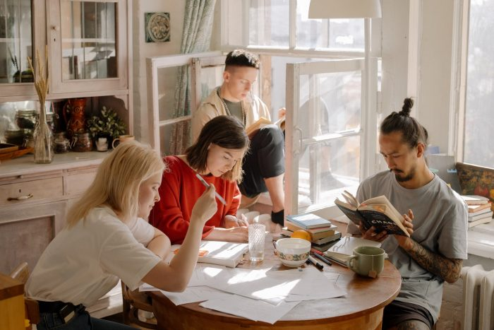 Group of people sitting in kitchen