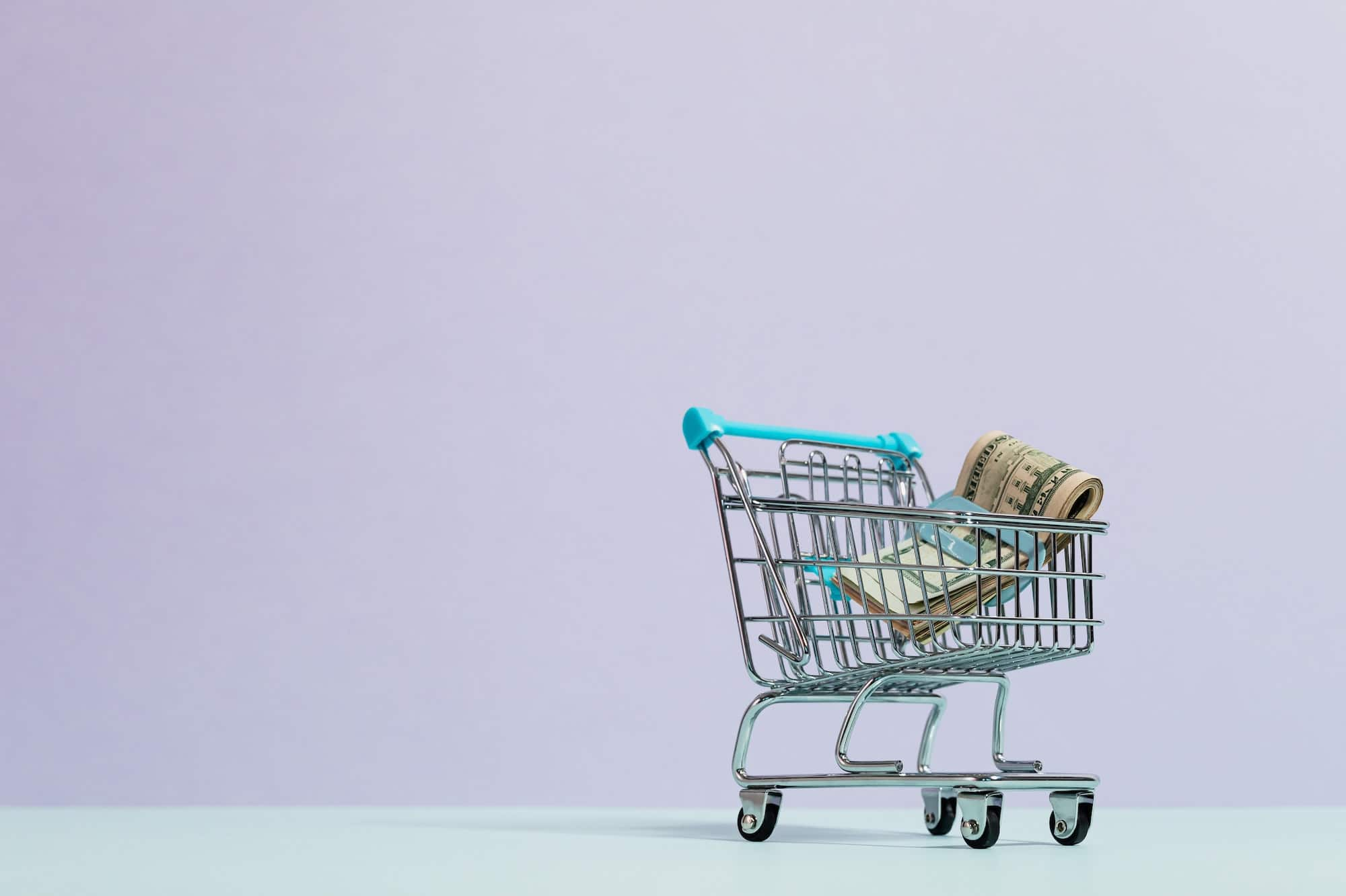 shopping trolley and money