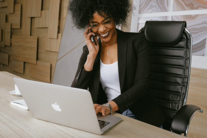 woman on phone laughing