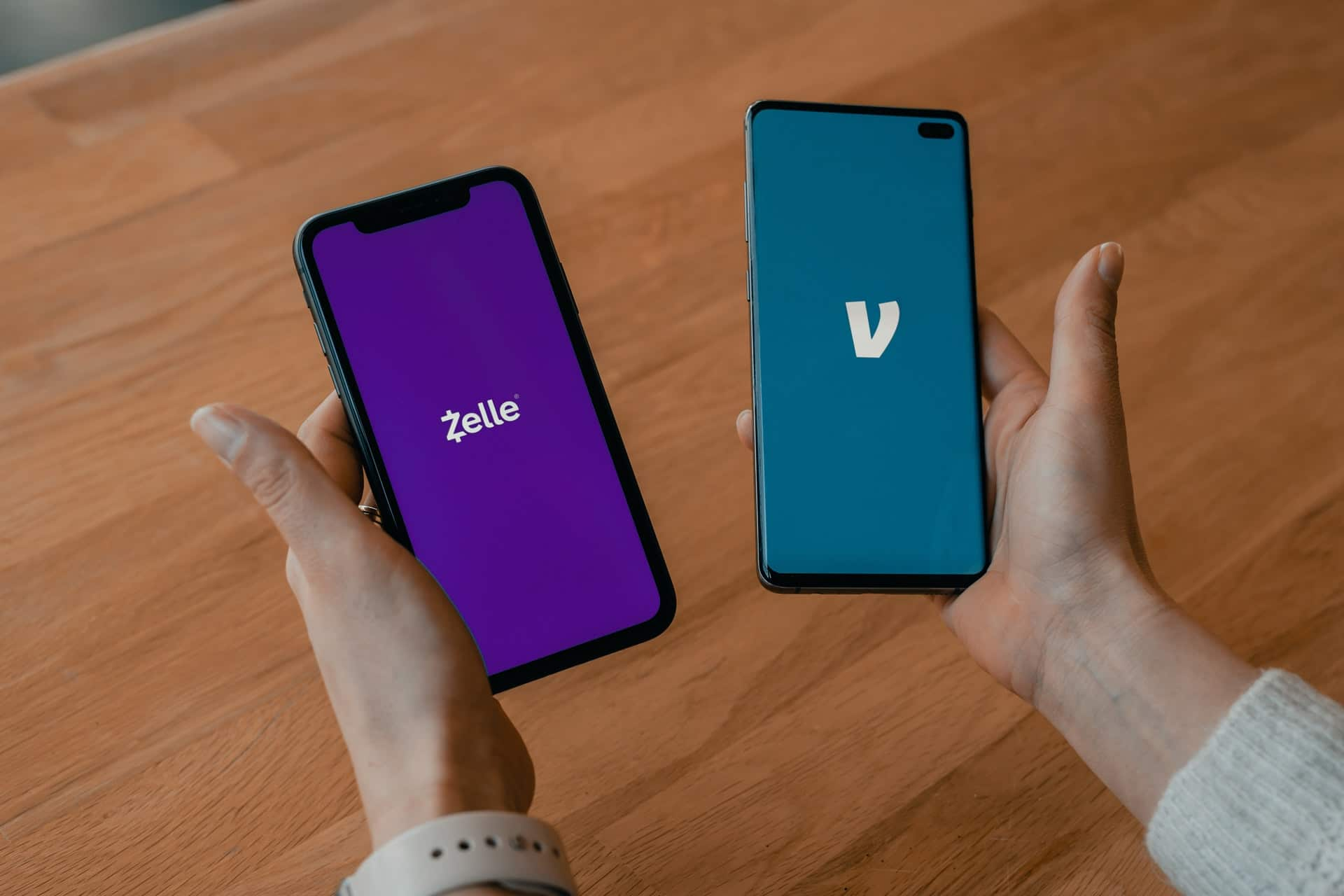 Two phones showing investing apps